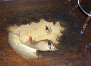 Face on floor