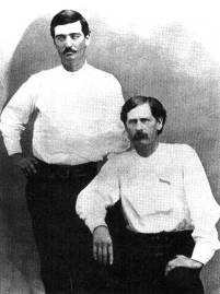 Bat Masterson (standing) and Wyatt Earp in 1876, when they were deputies in Dodge City, Kansas.
