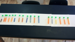 Results of rhodizonate test, with colors ranging from orange (no lead) through yellow (moderate lead) to green and blue (high lead). The test was qualitative, not quantitative.