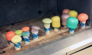 Polyurethane foam mushrooms colored with food coloring.