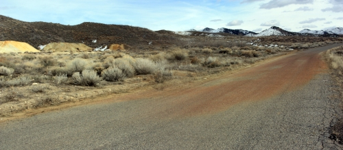 Staining on the asphalt where water draining off of the Swansea mine dump runs over the road near Silver City.