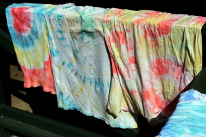 Tie-dyed shirts showing different patterns.