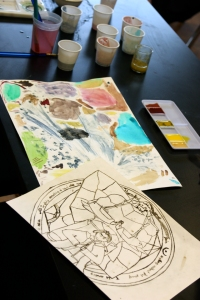 Alec's Anime drawing. Behind it are pigments we made for watercolors. Stay tuned for that post!