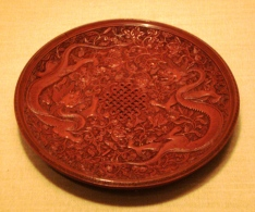 Chinese red lacquerware box colored with Chinese red, or cinnabar.