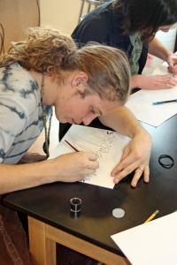 Zach practices daring Elvish calligraphy using homemade ink