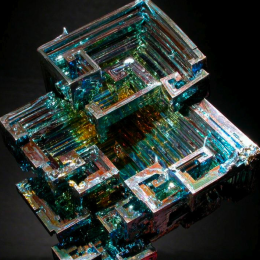 A synthetic bismuth crystal. Notice the play of colors across its surface.
