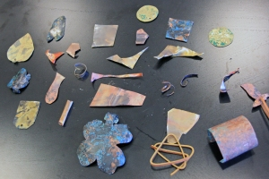 Shapes cut from sheets of copper and brass, treated with vinegar and salt (green patina) and ammonia and salt (blue patina).