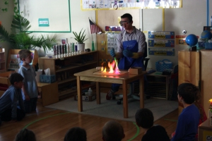 Evan demonstrates the colors of salts in methanol flames for a kindergarten class. Note: We were careful to follow safety precautions and use only small amounts of methanol, keeping the bottle well away from the flames.