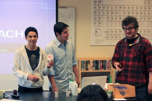 Elijah and Ben demonstrate how to use lip prints in forensic science, with some help from Joshua.