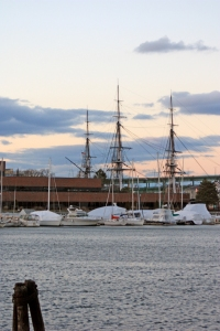 The masts of the U.S.S. Constitution, looking across the Charles River and Boston Harbor to Charlestown.