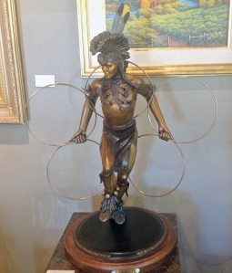 Hoop Dancer, a bronze statue on display at Adonis Bronze