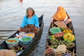 Ladies selling fruit and vegetables from their long boats at the Lok Baintan floating market on the Martapura River.