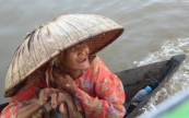 A lady at the Lok Baintan floating market in a traditional hat. It was worth traveling all this way just to get this one photo.