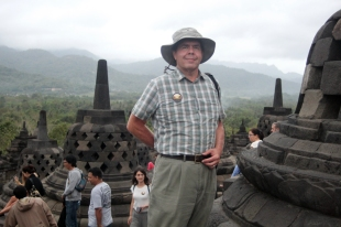 David at Borobudur with mountains