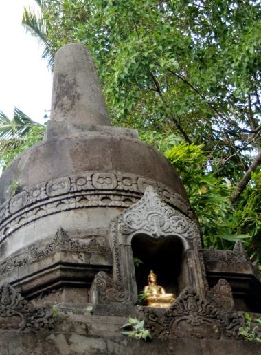 Gold Buddha in stupa
