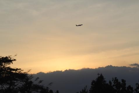 Jet against sunset