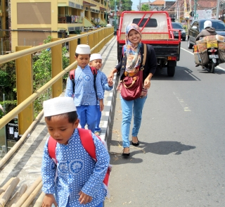 Little boys on bridge