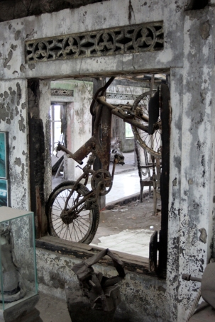 Ruined bike in window