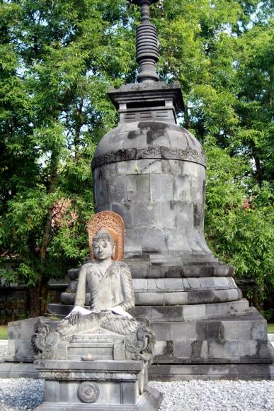 Seated Buddha with bronze head