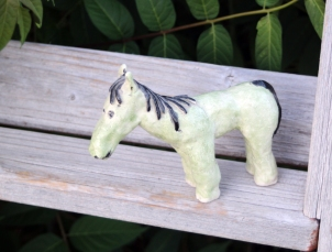 Green horse on steps-s
